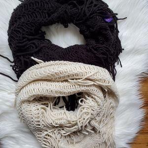 Bundle of fringe infinity scarfs